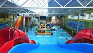 KuponMania.ru! Целый день в аквапарке Аква-Юна серфинг, горки, водопады, гейзеры, бильярд, сауна для взрослых и детей!